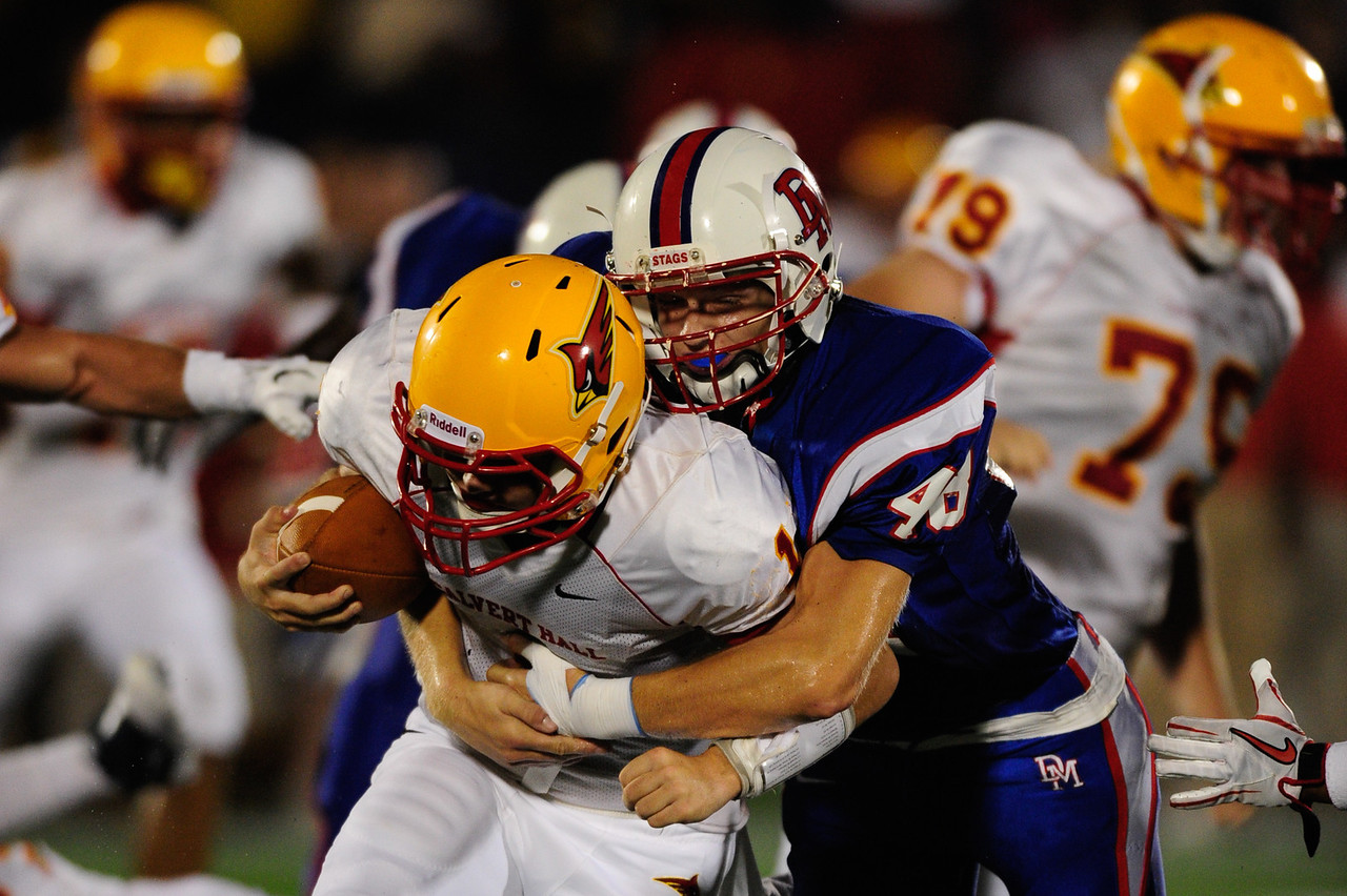 Sept 9, 2011 : DeMatha's Spencer Kleinrichert (48) makes a tackle during action at the 2011 Patriot Classic Football tournament at the United States Naval Academy Stadium in Annapolis, Maryland. Calvert Hall dominated and came away with a 18-0 victory over DeMatha.