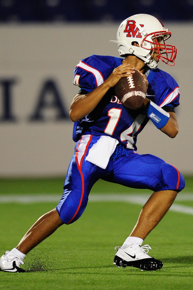 Sept 9, 2011 : DeMatha's QB Demory Monroe (14) during action at the 2011 Patriot Classic Football tournament at the United States Naval Academy Stadium in Annapolis, Maryland. Calvert Hall dominated and came away with a 18-0 victory over DeMatha.