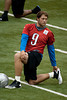 July 27, 2012; Allen Park, MI, USA; Detroit Lions quarterback Matthew Stafford (9) stretches during training camp at the Detroit Lions training facility. Mandatory Credit: Tim Fuller-US PRESSWIRE