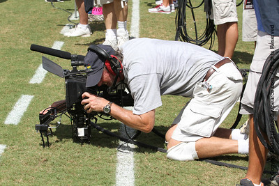 ESPN cameraman working hard with his 3D handheld.  Those things look heavy! Don't miss new photos.  Get notifications via:
