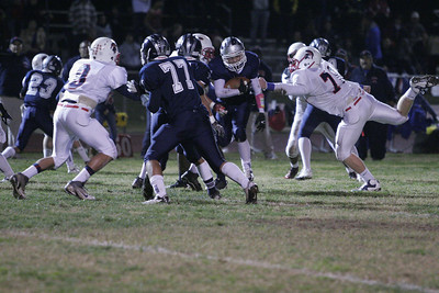 Farmersville RB Anthony Azevedo (2) runs for tough yardage against Strathmore's Nick Gomez (8) and Matt Redfern (70)
