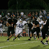 Woodlake Tiger Elijah Cummingham (1) rushes with Woodlake Tiger John Kulick (23) leading the way.