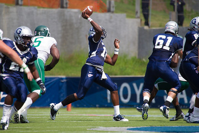 Hoyas quarterback Aaron Aiken launches a pass