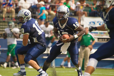 Hoyas quarterback Aaron Aiken (12) and Nick Campanella (10)