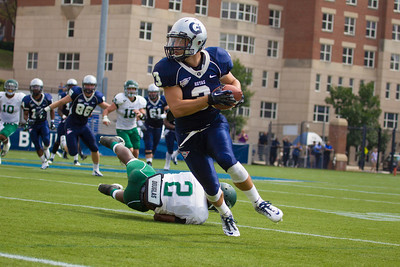 Max Waizenegger (3) of Georgetown runs around end for more than 20 yards past Sidiq Soulemana (2) of Wagner.