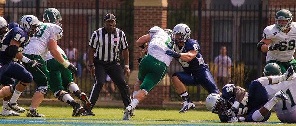 Wagner Seahawks quaterback Nick Doscher (8) is met by Hoyas Jeremy Grasso (6).