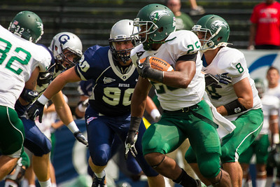Wagner's Dominique Williams (25) is chased by Hoyas' Alec May (90)