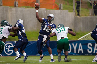 Hoyas quarterback Aaron Aiken is rushed by Wagner's C.O. Prime