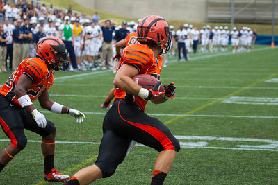 #28 Phillip Bhaya  of Princeton intercepts an Isaiah Kempf pass intended for Georgetown's #43 Justin Hill