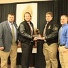 Passing The School Traveling Offensive Lineman Trophy from 2013 Jed Scott to 2014 Zachary Davis.