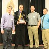 Passing the Traveling School Trophy from Luke Washburn Def 2013 Winner to Zordan Holman Def Lineman Winner 2014 Cheverus. Congratulations!!!
