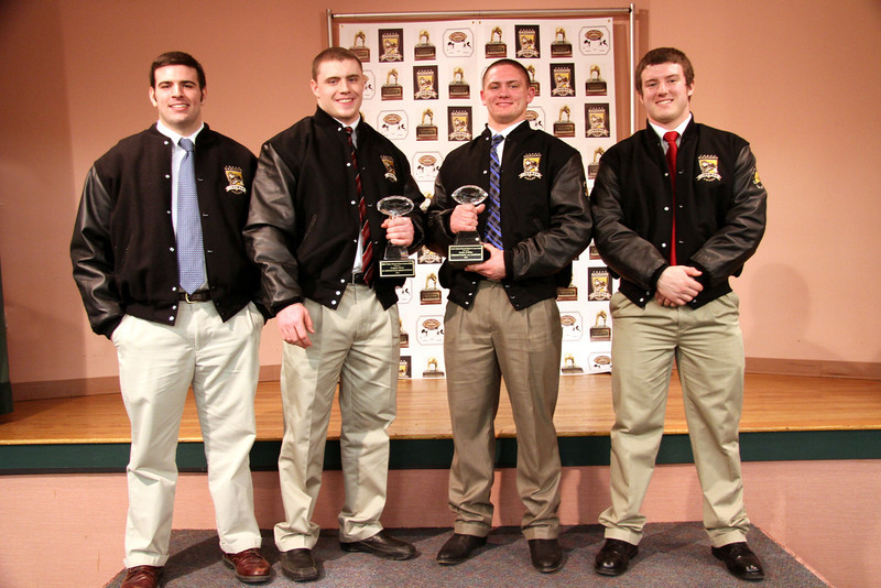 left to right:  Matt Welch 2010 Offensive Lineman Winner, Logan Mars 2011 Offensive Winner, Luke Libby 2011 Defensive Winner and Nate Martel 2010 Defensive Winner<br /> Four of Maine's Best Linemen!  Congratulations! And thank you Matt and Nate for coming back and passing on the Trophies this year.