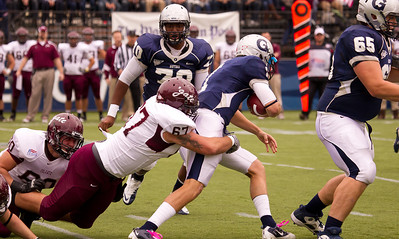 Hoyas' Isaiah Kempf (1) quarterback with ball is grabbed by Colgate's Chris Horner (67). Also on the play, Colgate's Zach Vinci (60) and Georgetown's Michael Francis (70) and Thomas Gallagher (65)