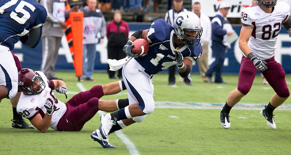 Hoyas Wilburn Logan (14) breaks away from Colgate's Vinnie Nicosia (20)