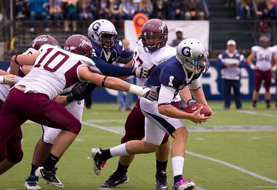 Georgetown's Isaiah Kempf (1) quarterback with ball. Also on the play. Hoyas' Kevin Sullivan (60) and Colgate's Andrew Nairin (10) and Chris Horner (67).