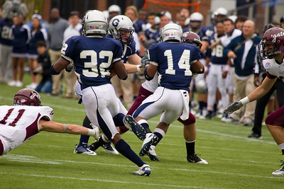 Hoyas' Jeremy Moore (32) with ball Wilburn Logan (14) blocking
