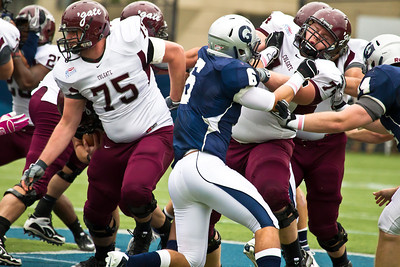 Colgate's Craig Capodiferro (75) and Ryan Risch (74) battle Georgetown's Kevin Bond (66)