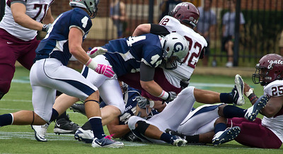 Colgate's Nate Eachus  is tackled by Hoyas' Sean Campbell (44)