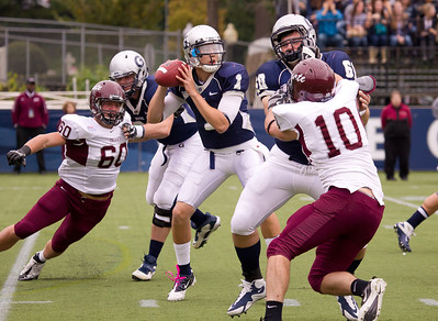 Hoyas Isaiah Kempf (1) quarterback with ball Kevin Sullivan (60) blocking Colgate's Zach Vinci (60) and Andrew Nairin (10)