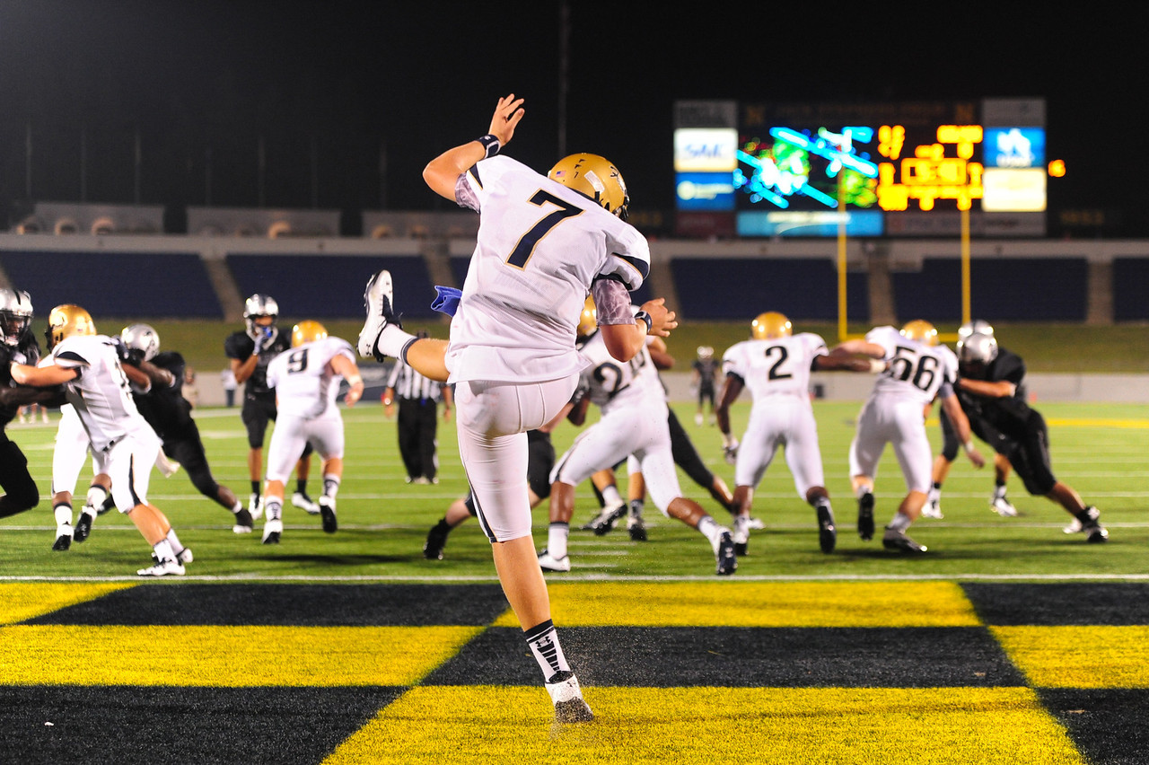 Sept 10, 2011 : Good Counsel quarterback Brendan Marshall (7) punts the ball from the end zone during action at the 2011 Patriot Classic Football tournament at the United States Naval Academy Stadium in Annapolis, Maryland. Good Counsel defeated Gilman 26-21.