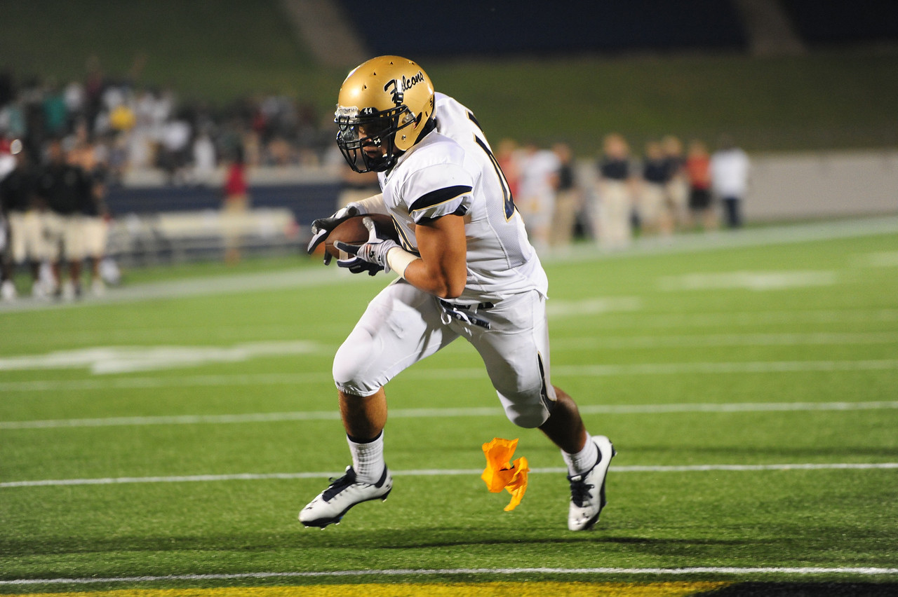 Sept 10, 2011 : Good Counsel's Drew Stefanelli (44) runs in for a touchdown as a flag is thrown his way during action at the 2011 Patriot Classic Football tournament at the United States Naval Academy Stadium in Annapolis, Maryland. Good Counsel defeated Gilman 26-21.