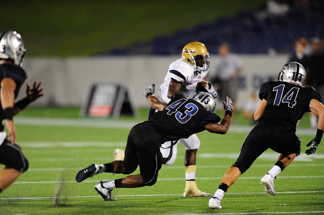 Sept 10, 2011 : Gilman's Micah Kiser (43) tries to tackle Counsel's Wes Brown (3) during action at the 2011 Patriot Classic Football tournament at the United States Naval Academy Stadium in Annapolis, Maryland. Good Counsel defeated Gilman 26-21.