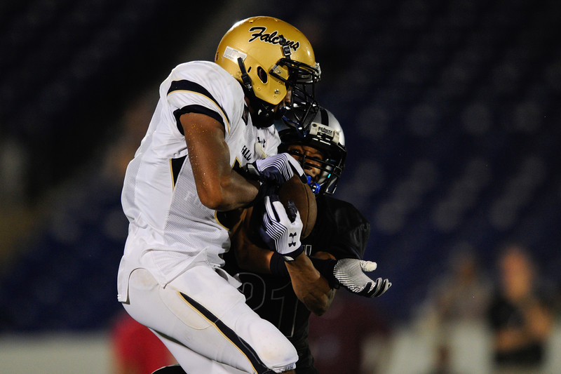 Sept 10, 2011 : Good Counsel's Kendall Fuller (5) jumps up to snag a pass while Gilman's defender Malcolm Powers (21) battles with him during action at the 2011 Patriot Classic Football tournament at the United States Naval Academy Stadium in Annapolis, Maryland. Good Counsel defeated Gilman 26-21.