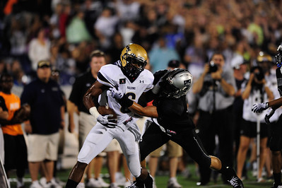 Sept 10, 2011 : Good Counsel's Dorian O'Daniel (6) tries to stiff arm a Gilman defender during action at the 2011 Patriot Classic Football tournament at the United States Naval Academy Stadium in Annapolis, Maryland. Good Counsel defeated Gilman 26-21.