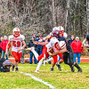 Tyngsboro's Kyle Corkum is knocked off balance by a  Groton-Dunstable defender. SUN/Ed Niser