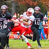 Groton-Dunstable senior Mitch Townsend lays a hit on Tyngsbsoro senior quarterback Kyle Laforge. SUN/Ed Niser
