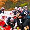 Groton-Dunstable quarterback Michael Tammaro is stopped at the line. SUN/Ed Niser