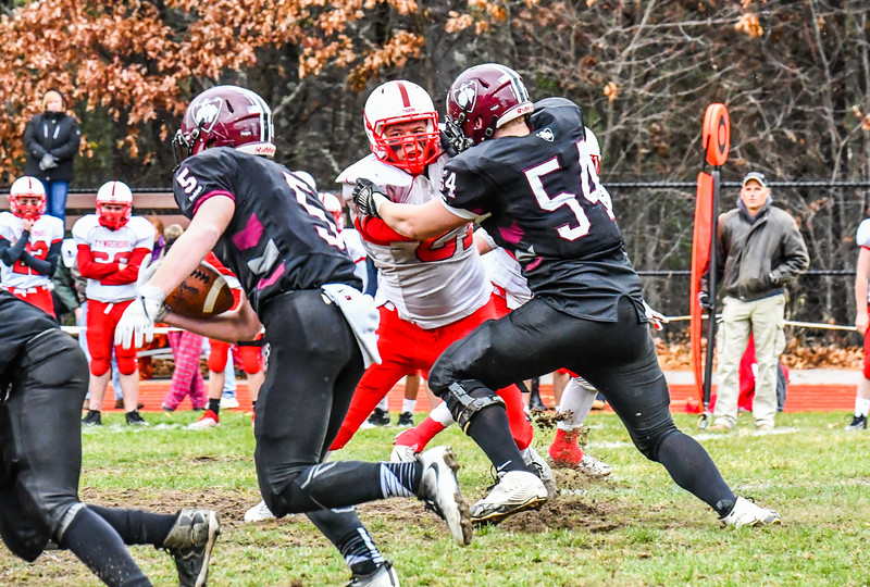 Groton-Dunstable's Max Morenz sets the edge aa Logan Higgins looks for some running room. SUN/Ed Niser