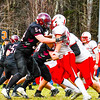 Groton-Dunstable offensive lineman Max Morenz engages in a block during Thursday's win over Tyngsboro. SUN/Ed Niser