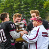 Head coach Tom Sousa presents the Colonel Prescott Cup to his team after its win over Tyngsboro. SUN/Ed Niser