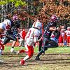 Groton-Dunstable quarterback Michael Tammaro looks for running room. Sun/Ed Niser