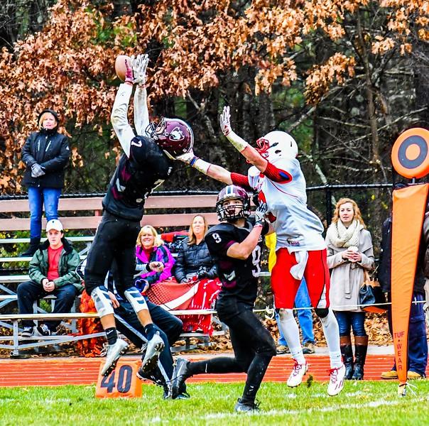 Groton-Dunstable's Nate Forbes intercepts a pass intended for Tyngsboro's Kyle Corkum. SUN/Ed Niser