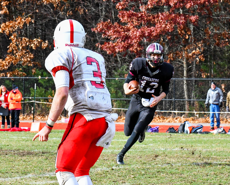 Groton-Dunstable quarterback Michael Tammaro looks for running room. Sun/Ed Niser