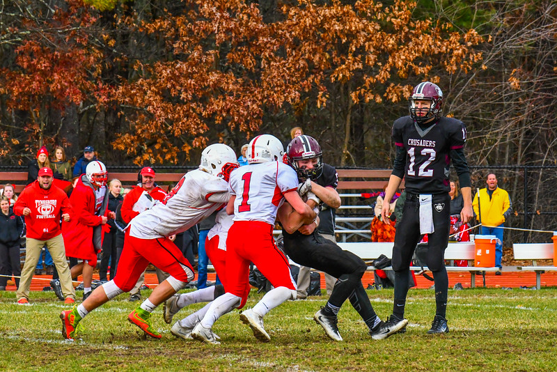 Groton-Dunstable running back Logan Higgins is met at the line by the Tyngsboro defense. SUN/Ed Niser