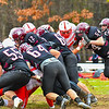 Groton-Dunstable quarterback Michael Tammaro gets the first down behind a push from his offensive line. SUN/Ed Niser