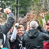 Groton-Dunstable football players and coaches present Groton-Dunstable Regional High School principal Michael Woodlock with the trophy, Woodlock is a former coach of Tyngsboro High School's football team. SuUNEd Niser