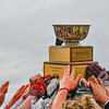 Groton-Dunstable players raise the Colonel Prescott Cup high after defeating Tyngsboro THursday morning. SUN/Ed Niser
