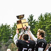 Groton-Dunstable players show off the Colonel Prescott Cup. Sun/Ed Niser