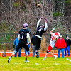 Groton-Dunstable's Connor Estes leaps to defend a pass intended for Tyngsboro's Kevin Butler. Sun/Ed Niser
