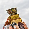 Groton-Dunstable players raise the Colonel Prescott Cup after defeating Tyngsboro on Thanksgiving morning. Sun/Ed Niser