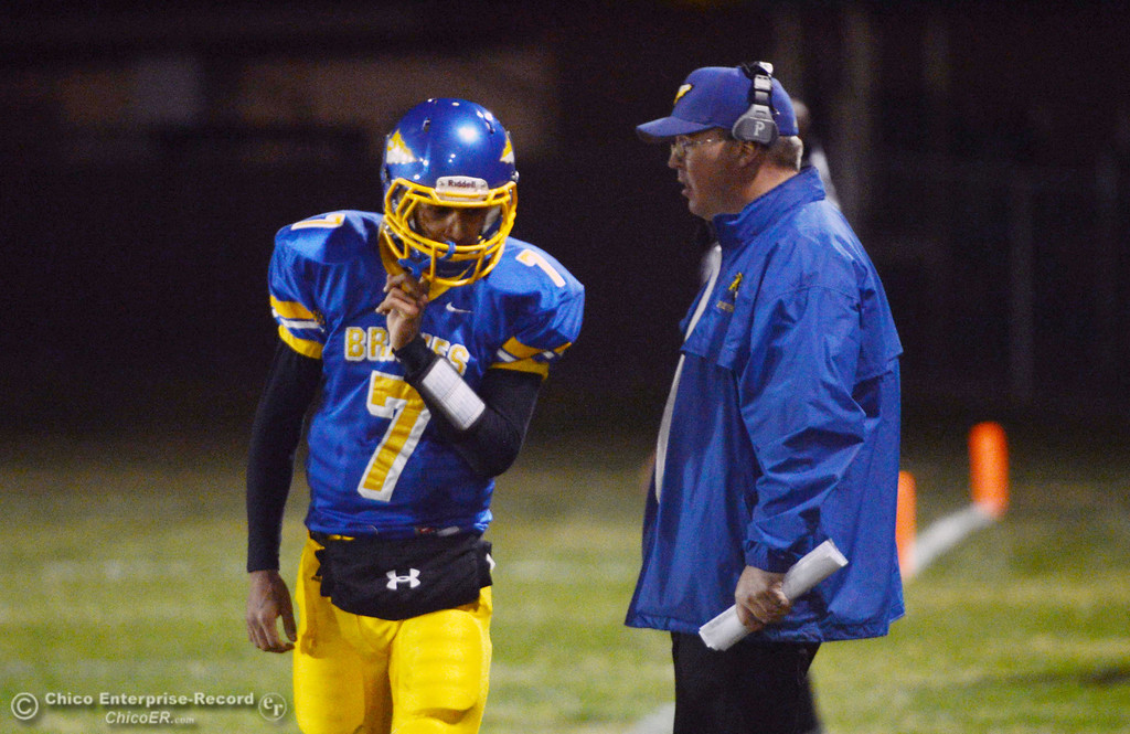 . Hamilton High\'s #7 Ricky Pompa (left) talks with coach Ryan Bentz (right) against Winters High in the first quarter of their football game at HHS Wednesday, November 27, 2013 in Hamilton City, Calif.  (Jason Halley/Chico Enterprise-Record)