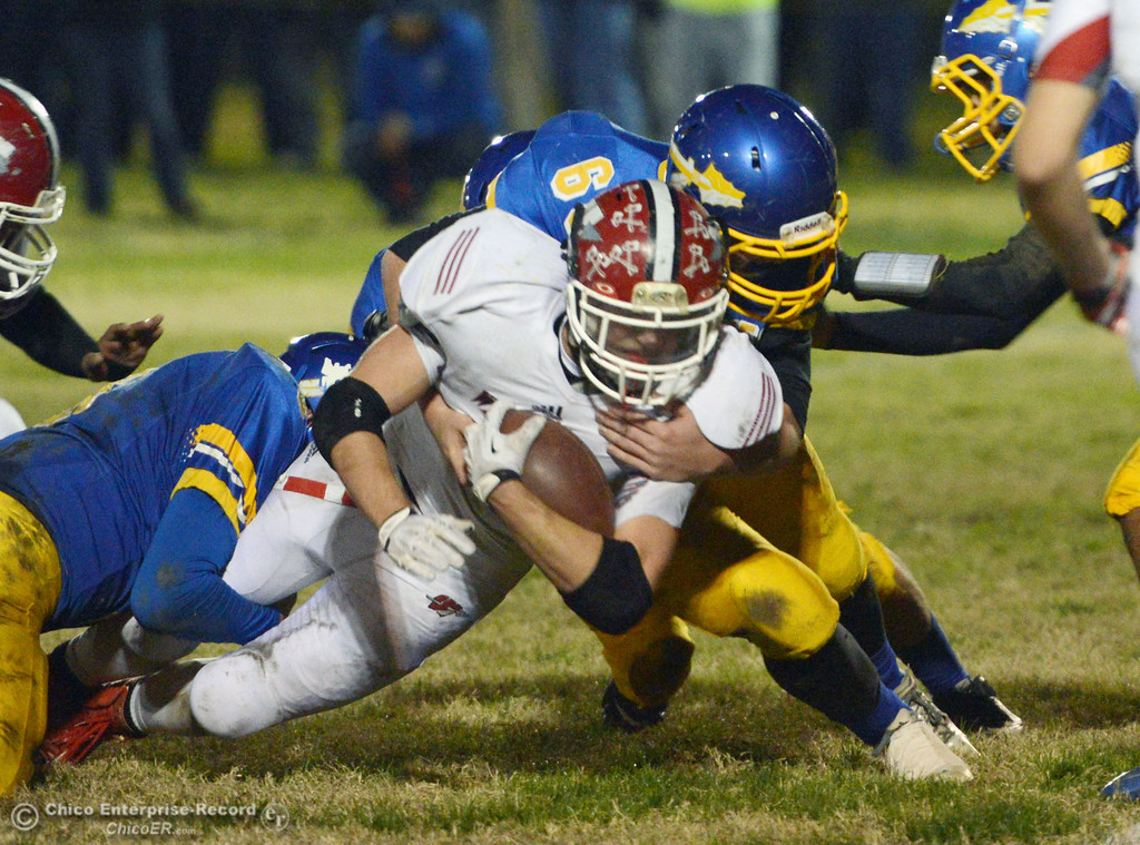 . Hamilton High\'s #68 Riley Meridith (back) tackles against Winters High\'s #4 Chaz Matthews (front) in the first quarter of their football game at HHS Wednesday, November 27, 2013 in Hamilton City, Calif.  (Jason Halley/Chico Enterprise-Record)