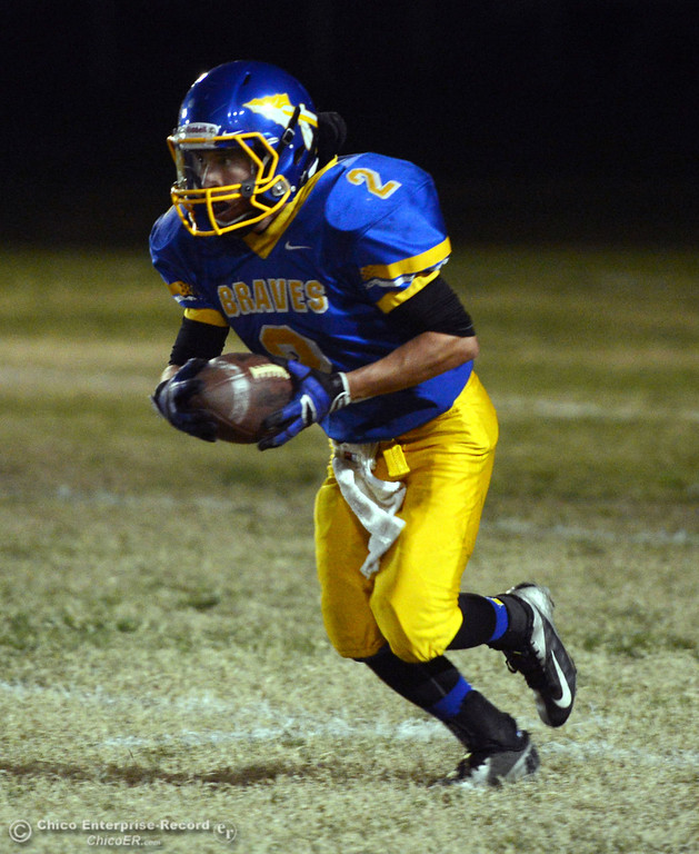 . Hamilton High\'s #2 Theron Fumasi runs the ball against Winters High in the first quarter of their football game at HHS Wednesday, November 27, 2013 in Hamilton City, Calif.  (Jason Halley/Chico Enterprise-Record)