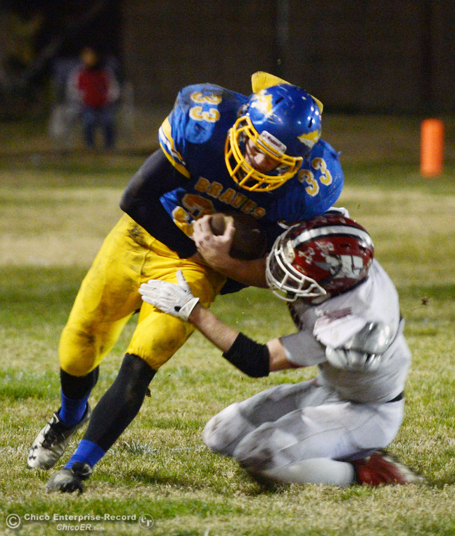 . Hamilton High\'s #33 Andrew Shippelhoute (left) is tackled against Winters High\'s #4 Chaz Matthews (right) in the second quarter of their football game at HHS Wednesday, November 27, 2013 in Hamilton City, Calif.  (Jason Halley/Chico Enterprise-Record)