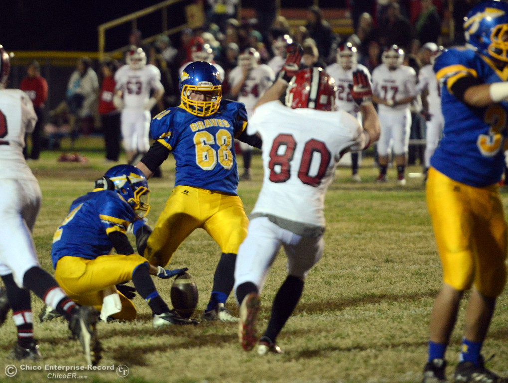 . Hamilton High\'s #68 Riley Meridith (center) kicks the extra point against Winters High in the second quarter of their football game at HHS Wednesday, November 27, 2013 in Hamilton City, Calif.  (Jason Halley/Chico Enterprise-Record)