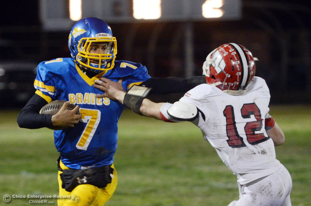 . Hamilton High\'s #7 Ricky Pompa (left) rushes against Winters High\'s #12 Jacob Lowrie (right) in the second quarter of their football game at HHS Wednesday, November 27, 2013 in Hamilton City, Calif.  (Jason Halley/Chico Enterprise-Record)